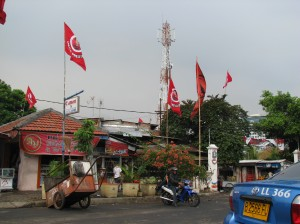 Buildings with flags from the party of Sukarno's daughter, Ibu Megawati, who was once president and is running again for the office.