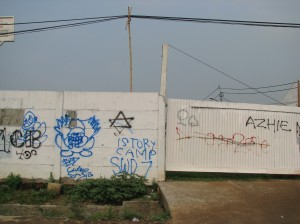 Graffitti on a wall in Jakarta.  The six-pointed star was commonly found on Jakarta's walls.  I asked what it meant and someone told me it was the insignia of a street gang while someone else told me it was a cigarette brand.