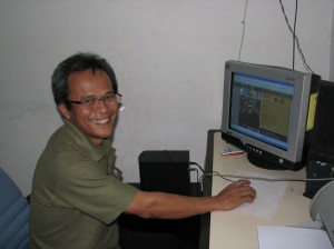 Mr. Edy Hendras, Indonesian conservationist extraordinaire, editing OFI's  Indonesian language newsletter