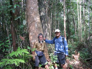 Mr. Freddy and Dayak village elder Mr. Ijai on forest land bought by OFI